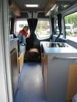 Cris at the back of the camper van